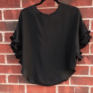 PONCHO STYLE TOP WITH RUFFLES